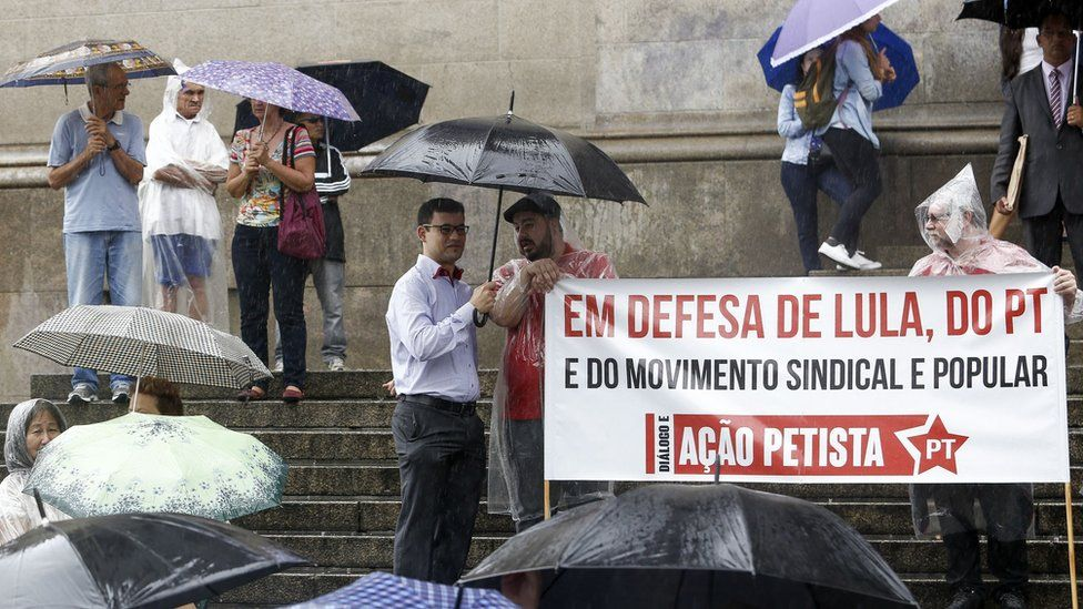 Unionists and members of the Workers Party (PT) demonstrate in support of Brazilian former president Luiz Inacio Lula da Silva in front of The Sao Paulo Cathedral in Sao Paulo, Brazil, on March 11, 2016.
