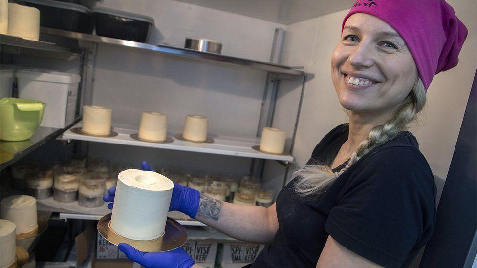 Uliana Timoreeva, baker at the Rottosrouva Bakery, creates a toilet paper cake, in Helsinki, Finland, 23 March 2020