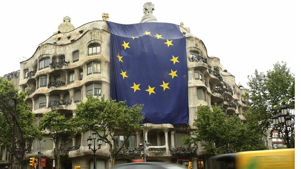 A giant EU flag is unfurled over Gaudi's La Pedrera building in Barcelona