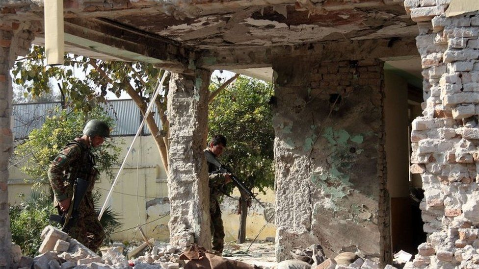 """Afghan security forces inspect a building, used by insurgents to launch an attack on Pakistan""""s consulate in Jalalabad, capital of Nangarhar province, Afghanistan, Wednesday, Jan. 13, 2016."""