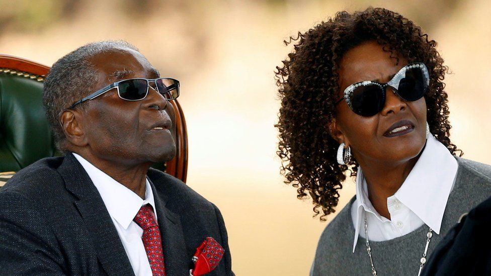 """Zimbabwe's former president Robert Mugabe and his wife Grace look on after addressing a news conference at his private residence nicknamed """"Blue Roof"""" in Harare, 29 July 2018"""