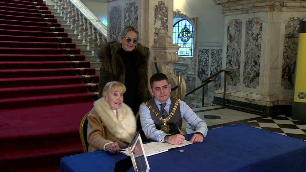 Sharon Stone, Betty Williams and Belfast Lord Mayor Daniel Baker signed the book of condolence