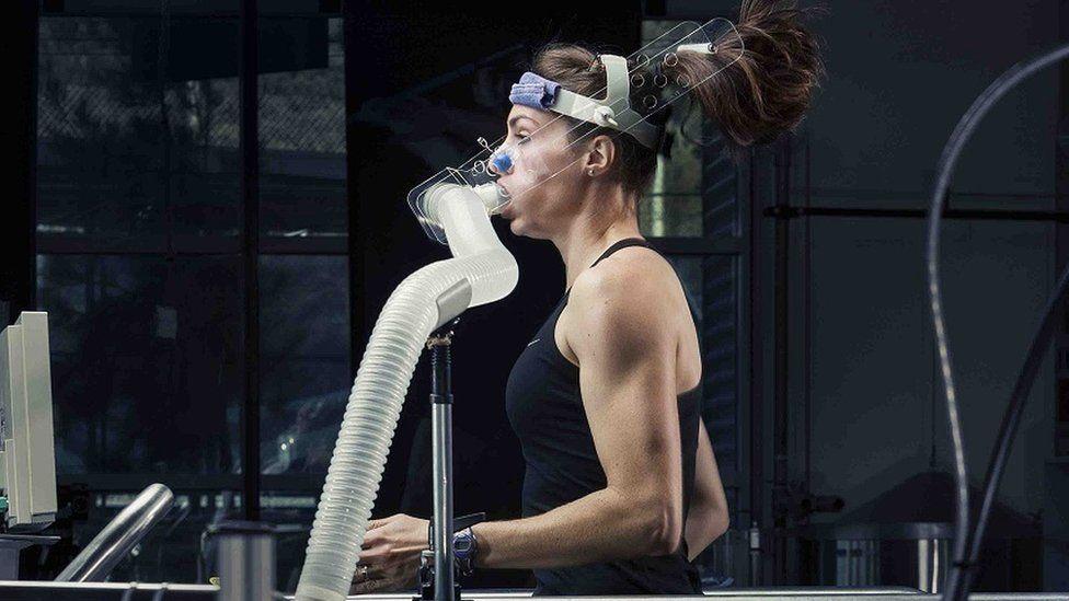 Female athlete wearing breathing apparatus