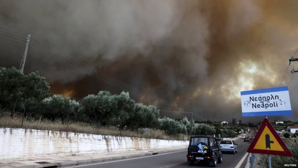 Smoke rises as a wildfire rages at the village of Neapoli in the region of Laconia in Peloponnese, southern Greece July 17, 2015