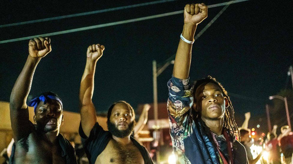Anti-racism protesters condemned the shooting of black man Jacob Blake on Sunday