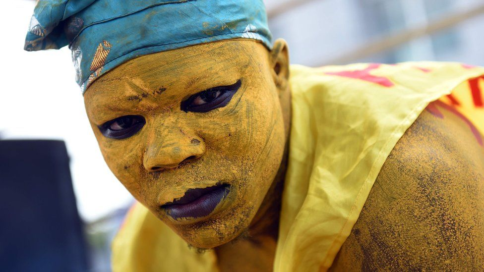 A supporter painted his face and body in yellow, the party's colour of former Prime Minister and presidential candidate Pascal Irenee Koupaki, during a political rally in Cotonou, on March 4, 2016