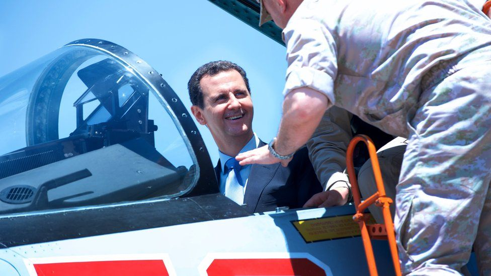 Syrian President Bashar al-Assad (L) during his visit to Hmaymim Russian military airbase in Latakia province, Syria (27 June 2017)