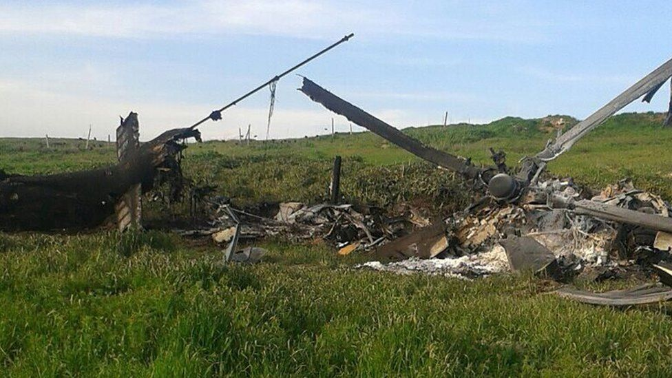 A picture obtained from the Nagorno-Karabakh defence authorities' official website reportedly shows the remains of the downed Azerbaijani Mi-24 helicopter in a field