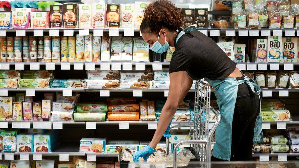 Supermarket worker in mask