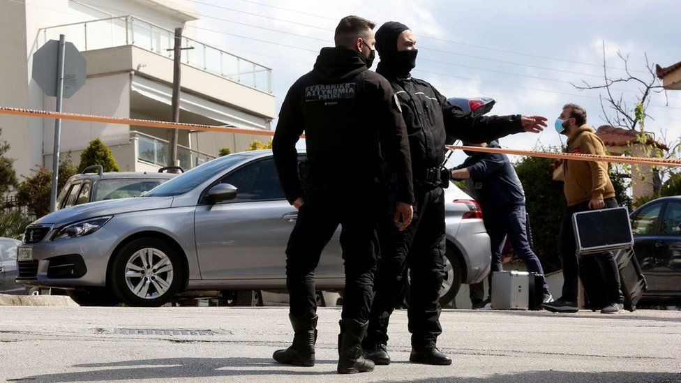 Police at the scene of the killing in Athens, 9 April