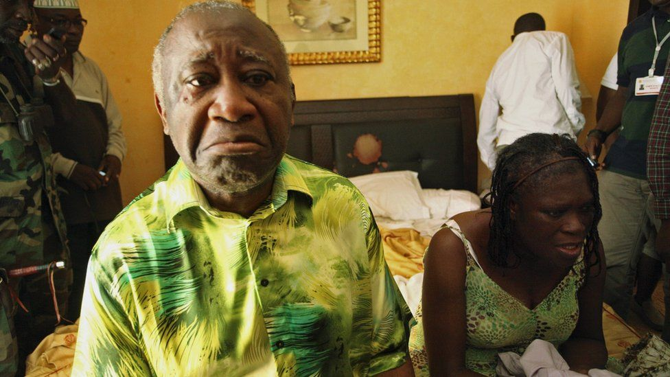 Laurent Gbagbo (L) and his wife Simone sit in a room at Hotel Golf in Abidjan, after they were arrested, April 11, 2011