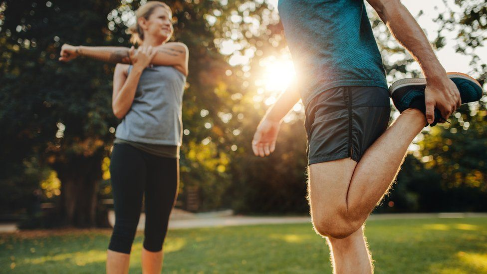 Man and woman exercising in the park