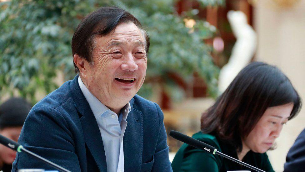 Huawei founder Ren Zhengfei (L) speaking to Chinese media in Shenzhen