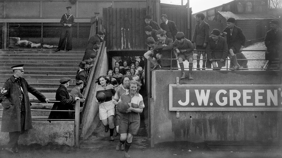 Photo of a ladies' football team running out onto the Luton Town pitch in 1935.