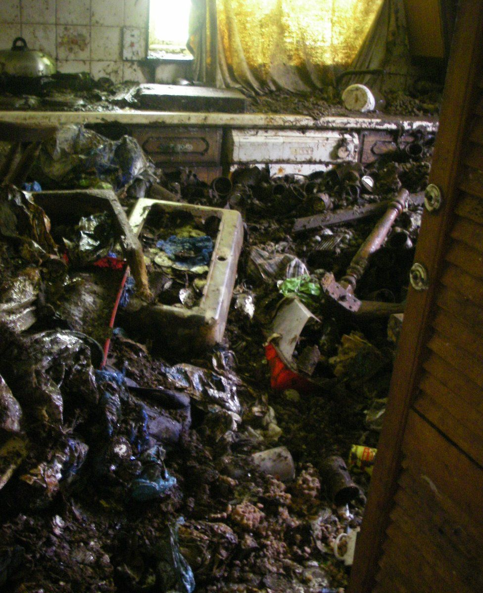 Rubbish and dirt inside the bungalow