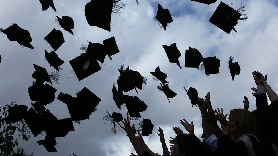 mortarboards in the air