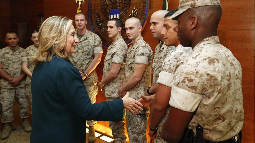 Hilary Clinton shakes hands with US troops on a visit to Afghanistan in 2011.