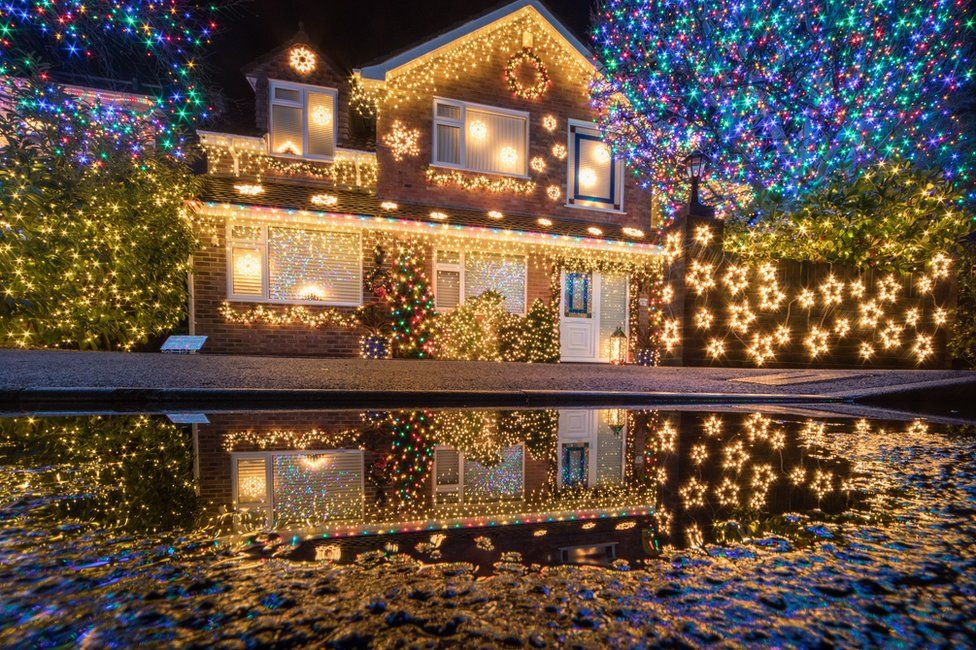 A house covered in lots of Christmas lights