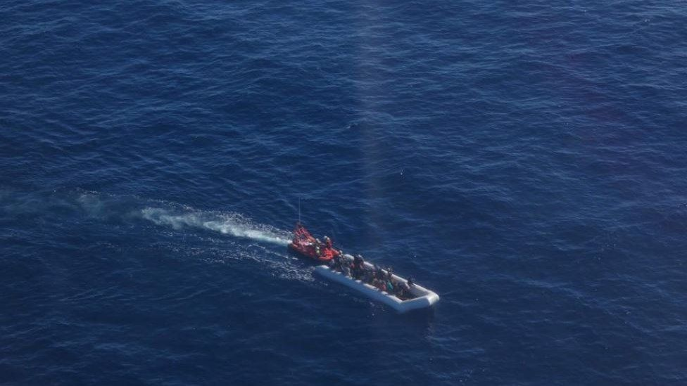 aerial photo of a boat in the sea