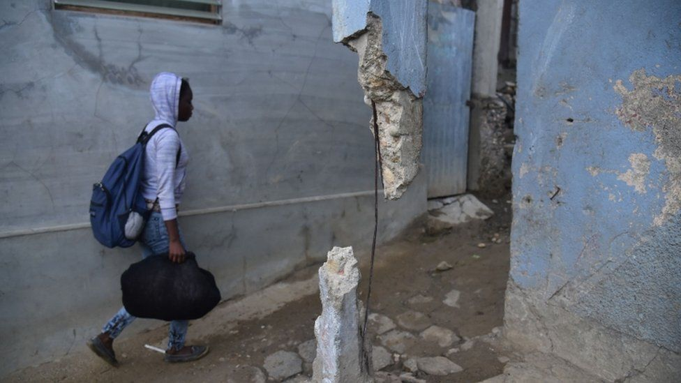 Haitian recover from an earthquake in 2018