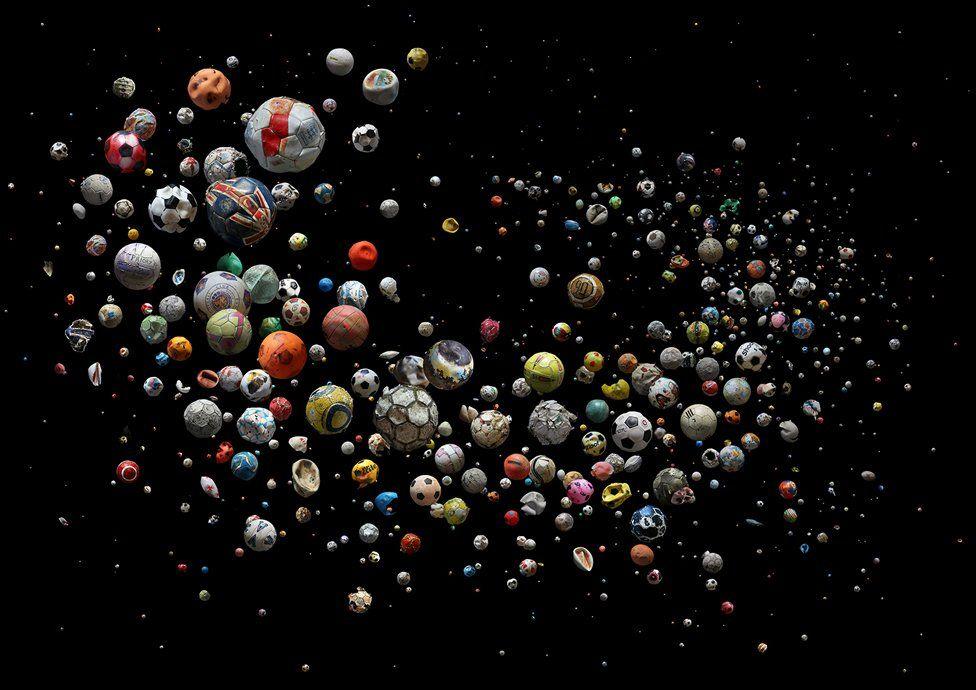 Collection of marine debris footballs against a dark background