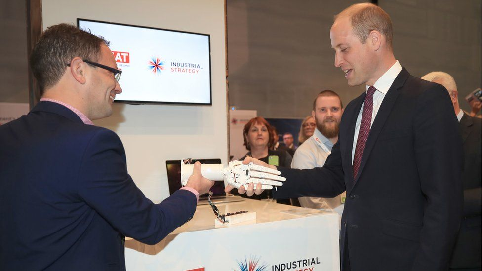 The Duke of Cambridge shakes hands with a robotic hand made by a 3D printer during a visit to the International Business Festival at the Exhibition Centre Liverpool