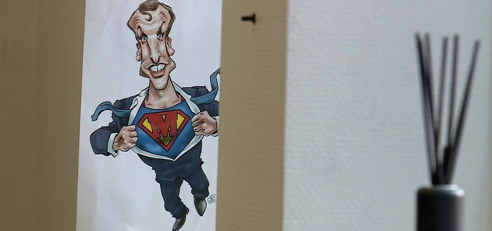 "A cartoon of ""Super Macron"""