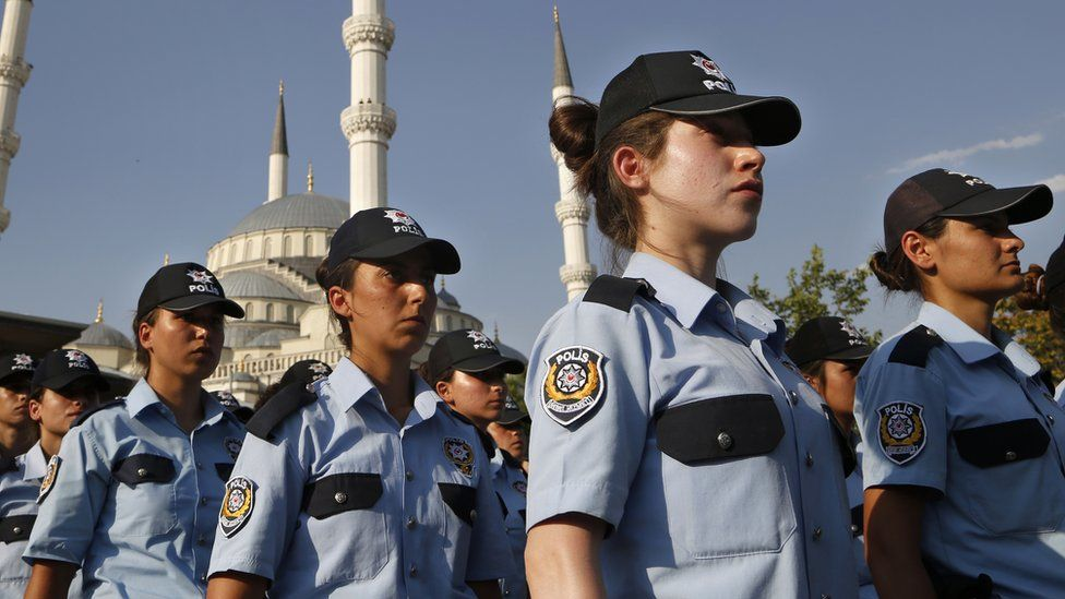 Rows of policewomen in uniform including baseball caps, at a mass funeral in Ankara for a policeman who died in Turkey's failed coup. 18 July 2016.