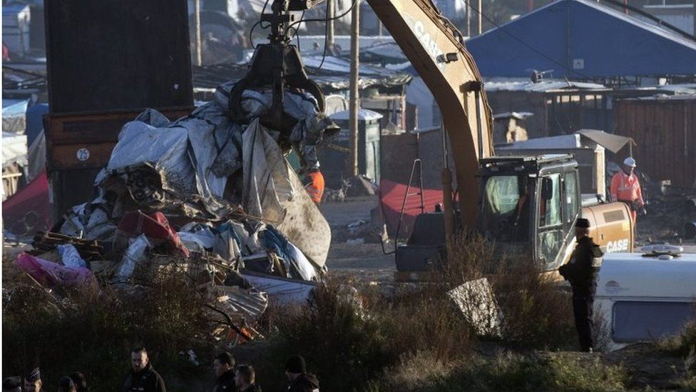 """Workers continue dismantling of the makeshift camp """"The Jungle"""" in Calais, France, 27 October 2016."""