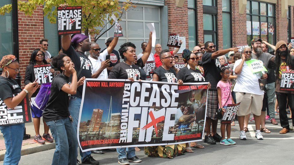 Ceasfire marchers move through downtown Baltimore