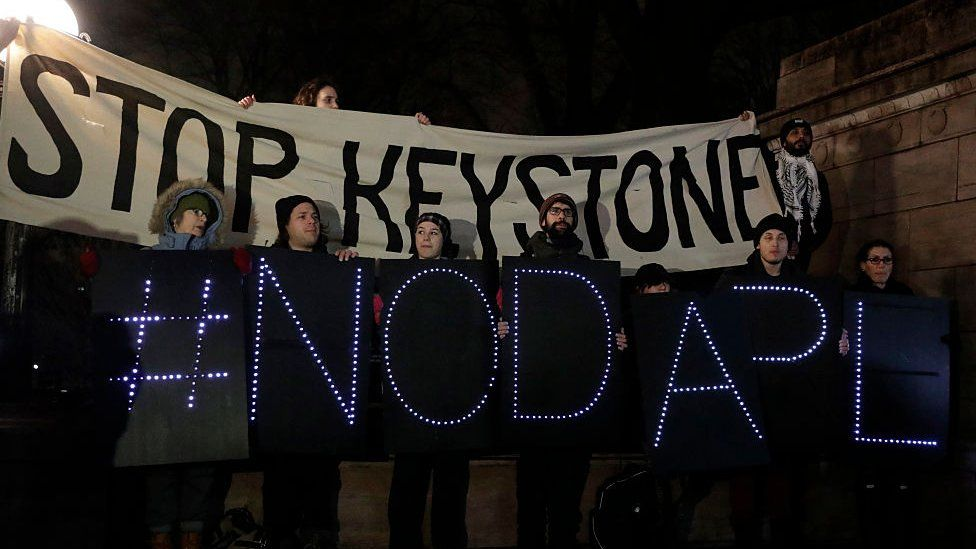 Opponents of the Keystone XL and Dakota Access pipelines hold a rally as they protest former President Donald Trump's executive orders advancing their construction