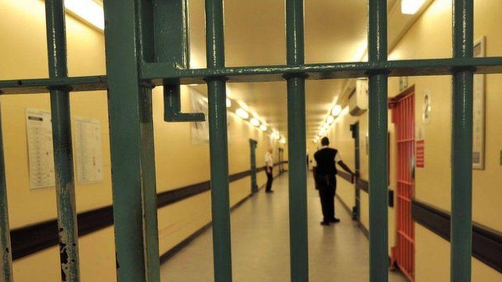 A barred door in Wormwood Scrubs prison
