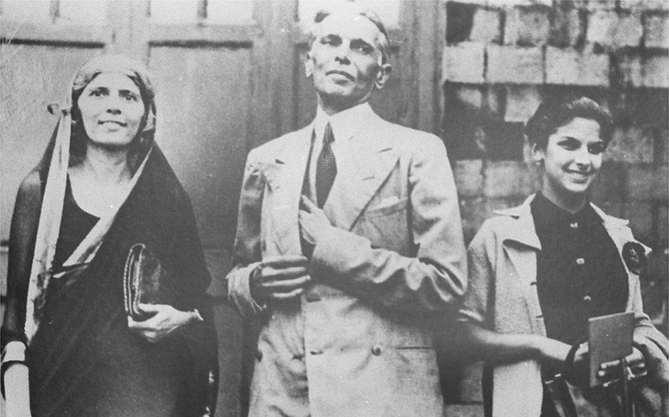 A black and white picture of a young Dina Wadia, shot at an undisclosed location with her father Mohammad Ali Jinnah, the founder of Pakistan, and aunt Fatima Jinnah