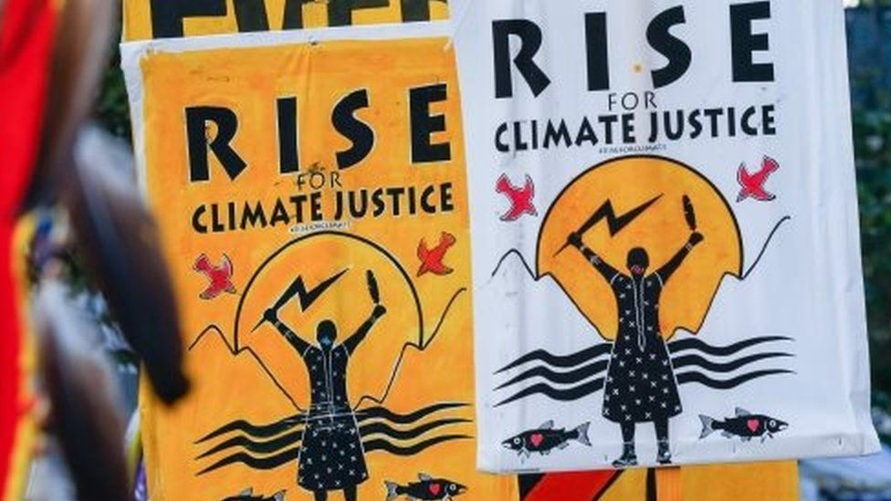 """Signs saying """"Rise for climate justice"""" are seen in San Francisco, California, USA on 8 September 2018"""