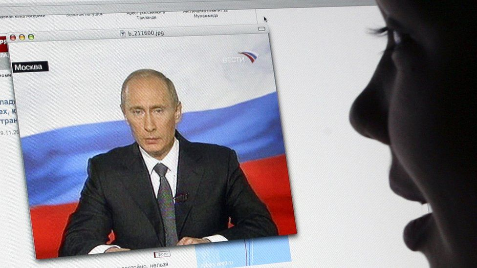 A girl watches Russian President Vladimir Putin's address to the nation on Russian TV Channel One's website