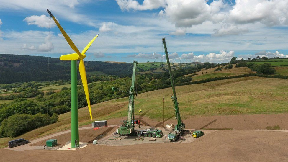 Yellow and green wind turbine in hills near Llantrisant, South Wales
