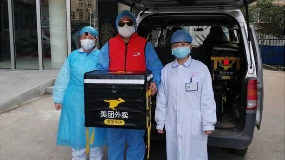 Medical staff take delivery of food