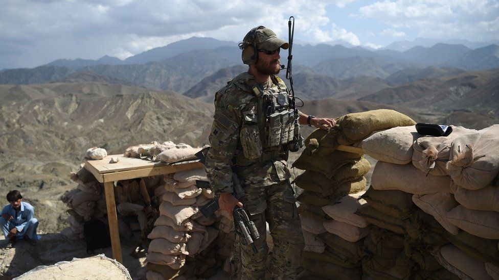In this photo taken on July 7, 2018, a US Army soldier from Nato and an Afghan Local Police (ALP) officer are seen in a checkpoint