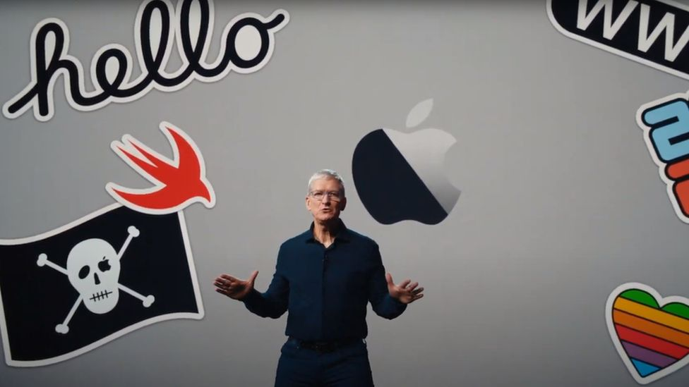 Tim Cook is seen against a backdrop