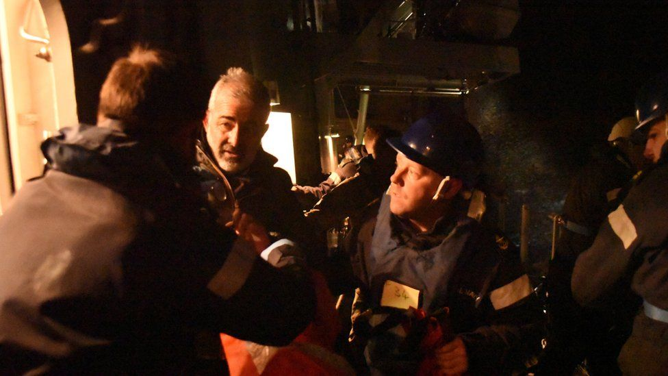 A Royal Navy picture handout of crew members being rescued