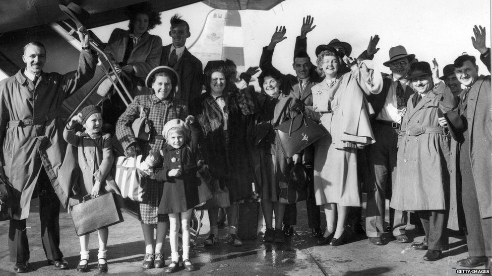 Migrant families wave goodbye as they leave Britain for new lives in Australia, 1948.