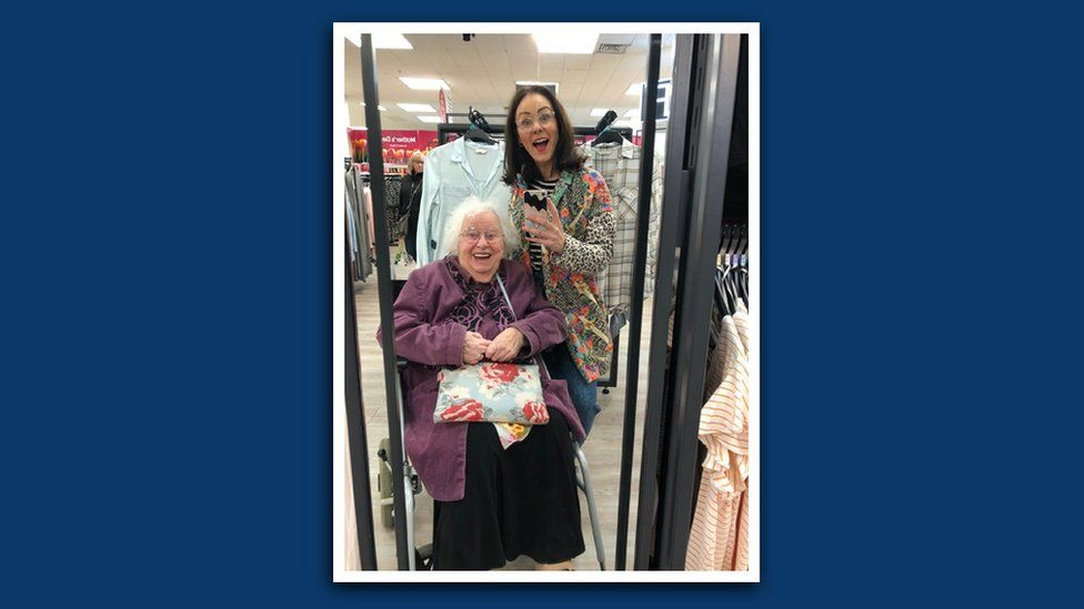 Jade and Mavis pose for a photo on their last shopping trip