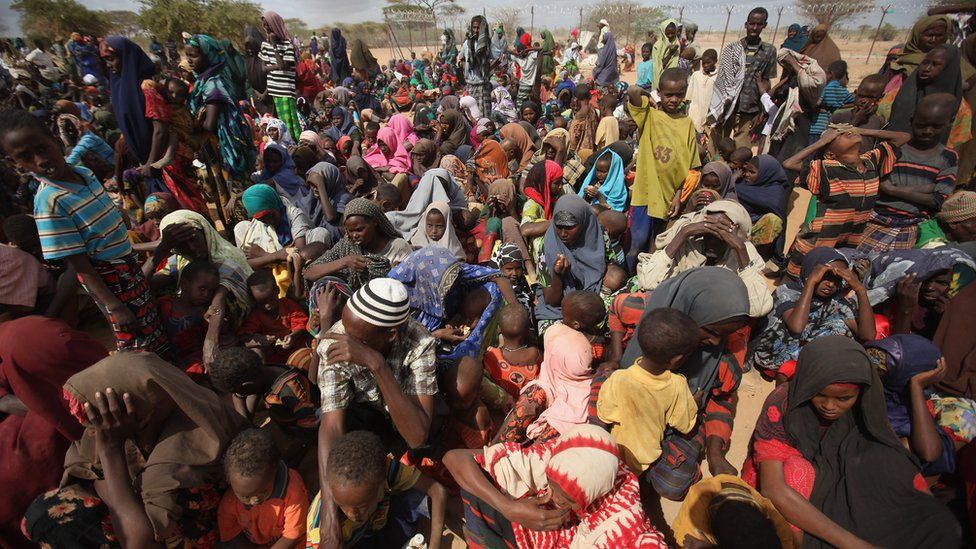 Somali refugees wait in the registration area of the Dagahaley refugee camp which makes up part of the giant Dadaab refugee settlement in Dadaab, Kenya