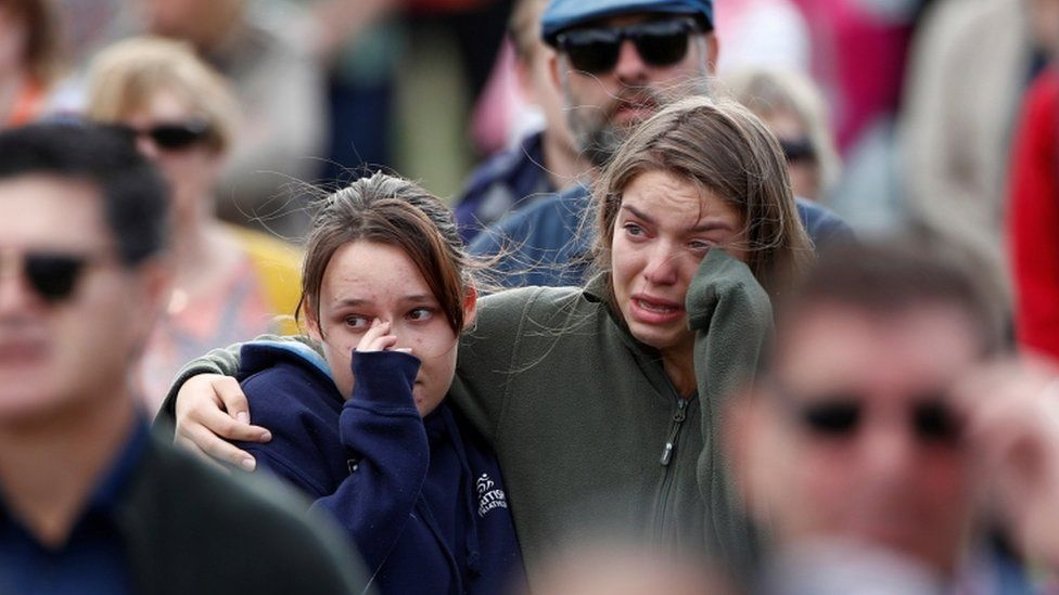 Two girls crying in the crowd at the remembrance service for victims of the mosque attacks