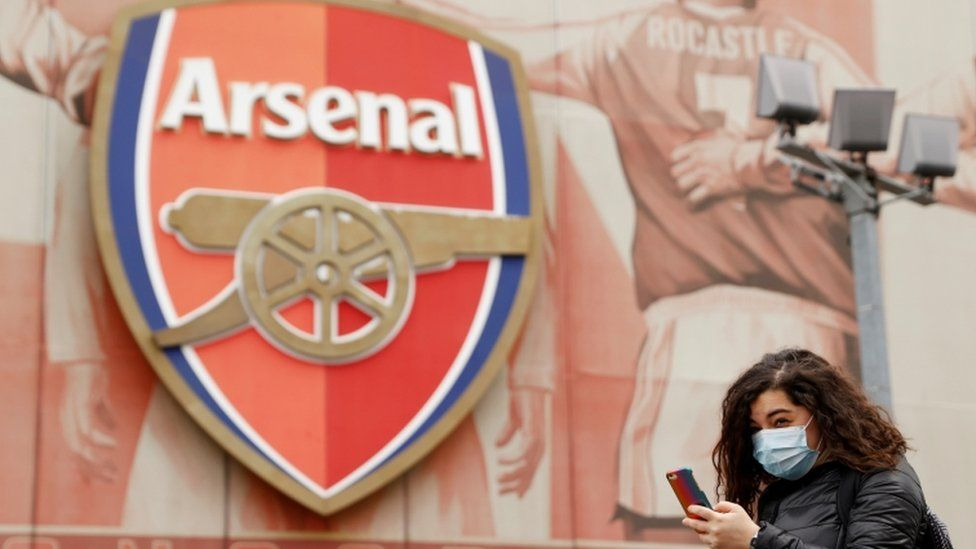 Woman in mask outside emirates