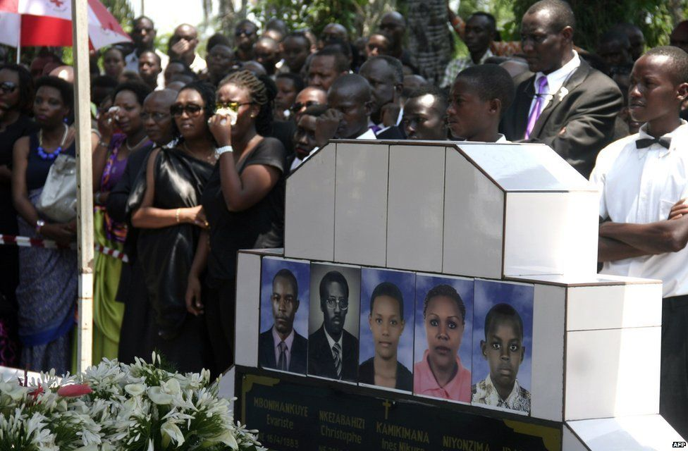 People attend the funeral of a Burundian journalist in Bujumbura on October 20, 2015, after they were shot dead on October 13