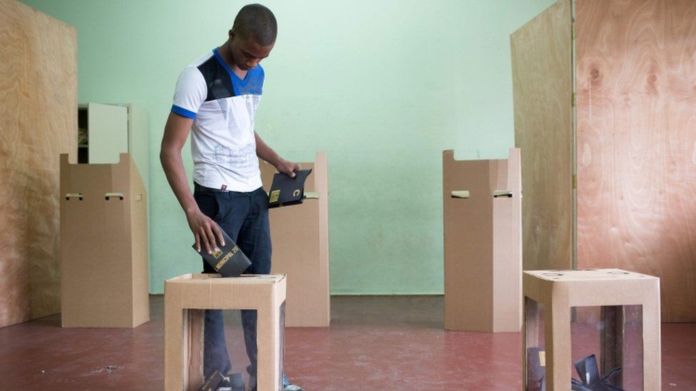 A man casts his vote at a polling station during general elections in Santo Domingo on May 15, 2016.