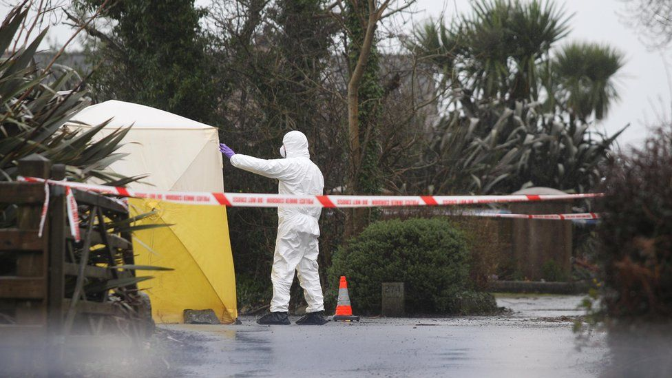 Forensic investigators at the scene of the murder