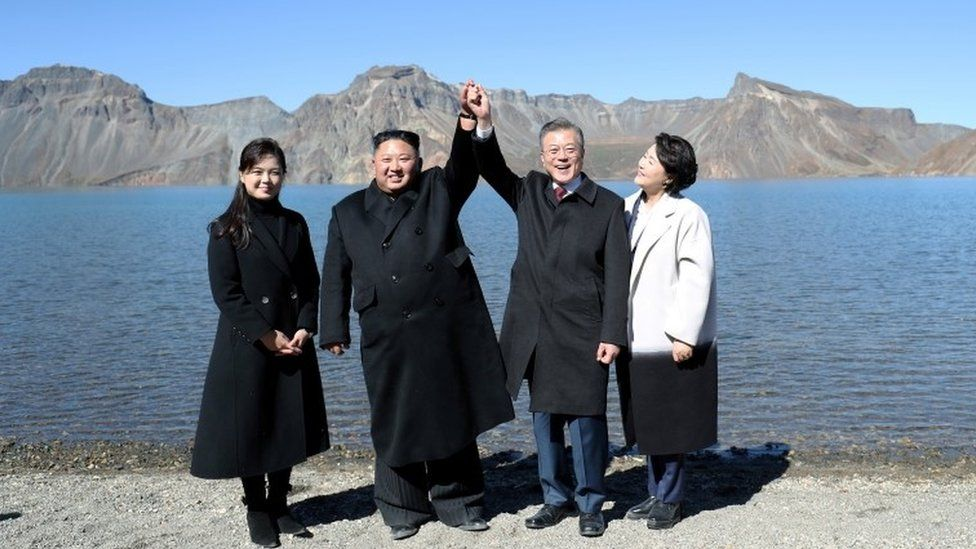Moon Jae-in and Kim Jong-un hold hands at the top of Mt Paektu in North Korea (Oct 2019)