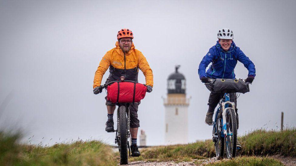 Two cyclists at Cape Wrath